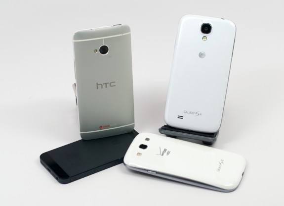 The Samsung Galaxy S4 and HTC One are likely behind a spike in Galaxy and iPhone trade-ins.