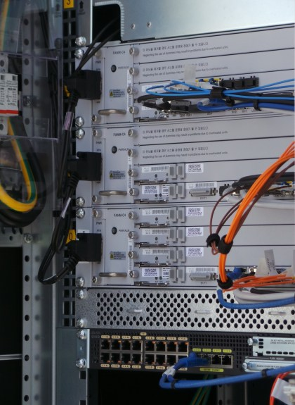 Each rack inside the box handles a specific frequency. Additional racks can be added when more spectrum gets acquired.