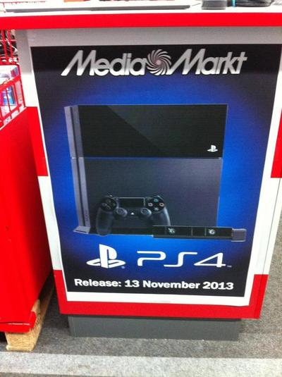 A poster at a major retailer shows a PS4 release date of November 2013.