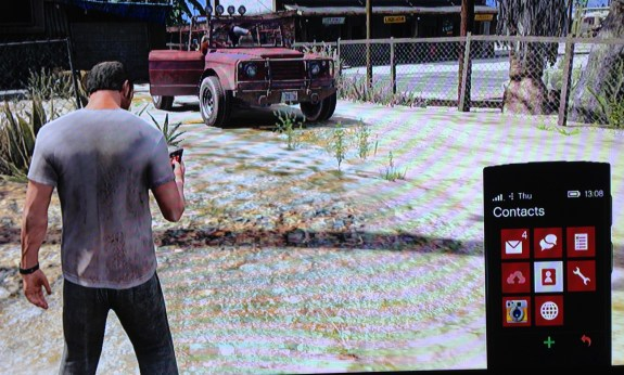 In GTA 5, the crazy guy is using Windows Phone.