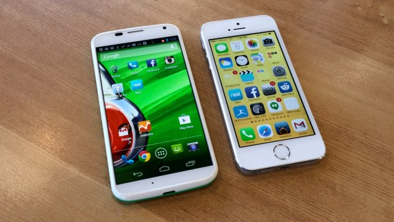 The Moto X features a 4.7-inch display and the iPhone 5s uses a 4-inch display, but the phones are similar in size.