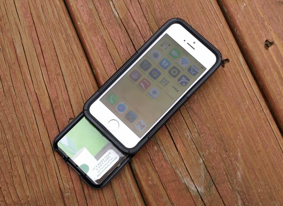 The iPhone 5s OtterBox Commuter Series Wallet holds three cards and one bill.