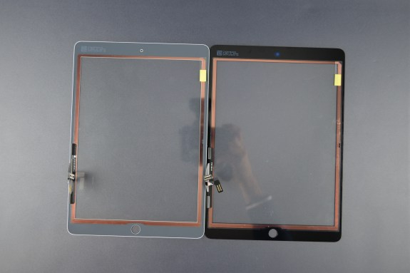 The glass front. likely of the iPad 5, contains the touch sensors.