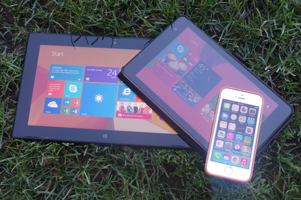 Testing displays under bright sunlight, but in the shade. From left to right: Nokia Lumia 2520, Dell Venue 8 Pro, iPhone 5s