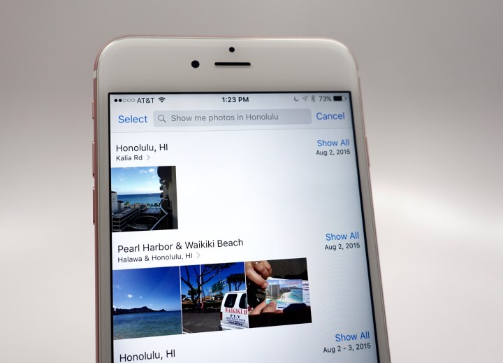 Siri can search your photos by voice.