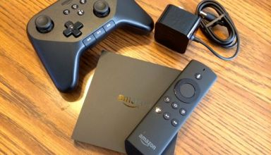 amazon firetv remote, gamepad and power cord