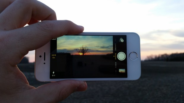 There is no live HDR mode on the iPhone 5s so you need to guess what you will see.