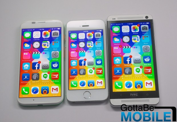 A Moto X on the left includes a 4.7-inch display, but is not much larger than the iPhone 5s with a 4-inch display.