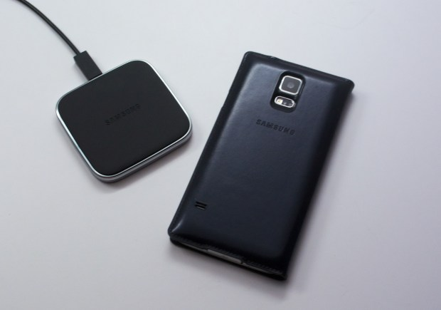The Galaxy S5 Wireless Charging S View Flip Cover and charger.