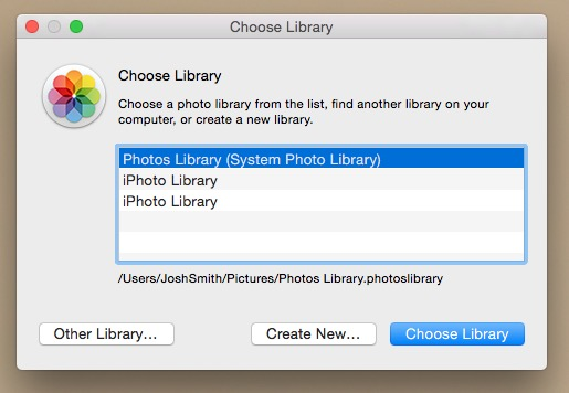 You can open multiple Photos Libraries.