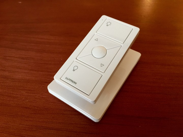 You can wirelessly control your lights with the small Pico remotes, like this one that is on a pedestal.