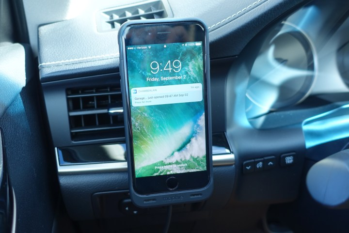 The iPhone stays on an easy to see vent mount magnetically and charges wirelessly.