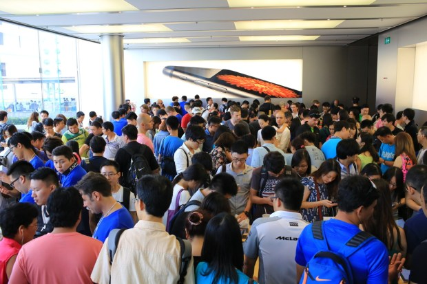 Imagine crowds like this where everyone wants to try on multiple Apple Watch models. Lewis Tse Pui Lung / Shutterstock.com