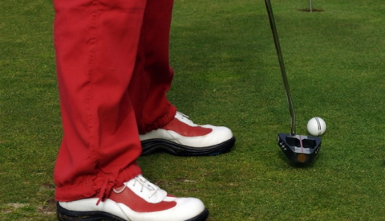 Image of golf shoes and pants