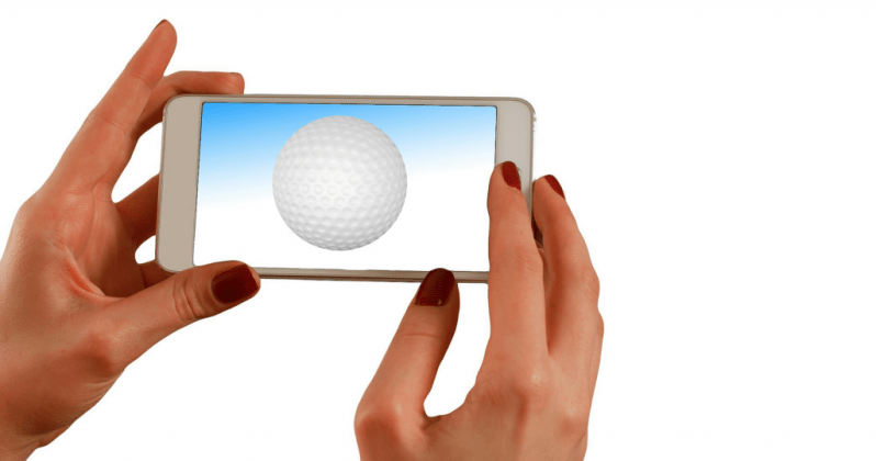 Image of woman watching golf video tips