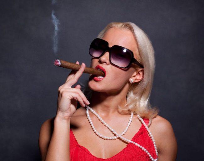 Image of woman smoking cigar