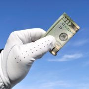 Image of hand paying a golf wager