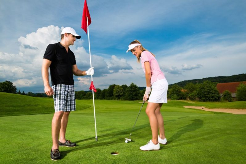 Image of couple on putting green