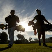 Image of golfing couple