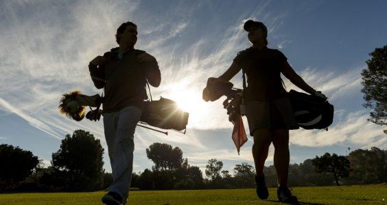 Image of golfing couple