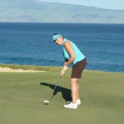 Image of woman playing golf at Kapalua