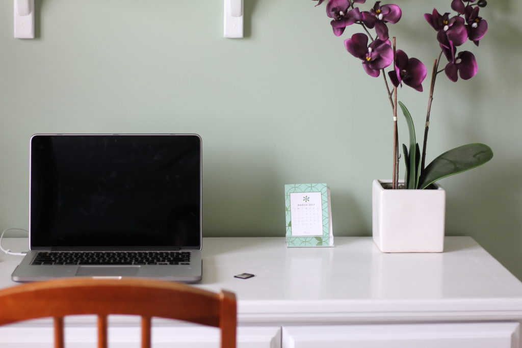 Home office white desk with decor