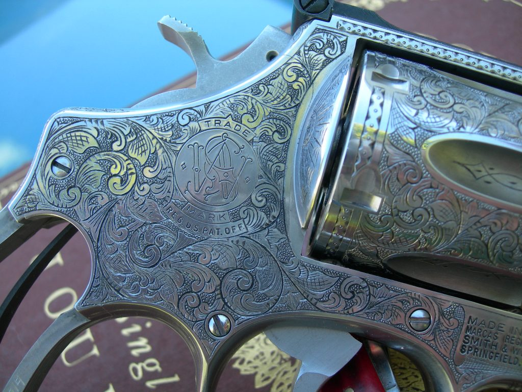 Beautifully engraved gun in American Scroll style.