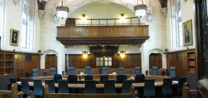 Inside a large courtroom