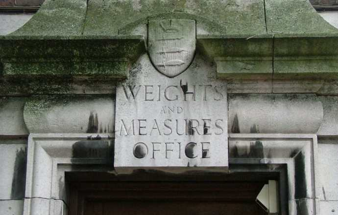 Old stone sign above door 'weights and measures office'