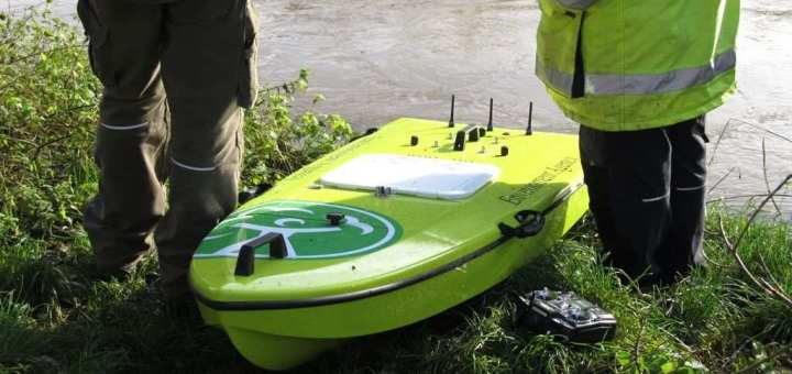 environment agency officers monitoring water