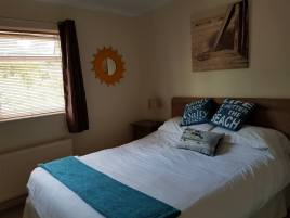 The bedroom at Sea Breeze Apartment 3, Horton, Gower