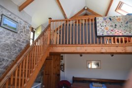 The staircase to the TV room at Delvid Stables holiday cottage, Llangennith, Gower