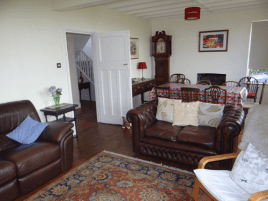 The sitting room and dining room at Sunnyside holiday home, Rhossili, Gower