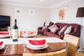 The dining and living areas at Honeywell Cottage holiday cottage, Oxwich Gower