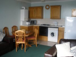 The kitchen and dining area at The Hollies, Horton, Gower