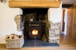The log burner stove at The Bower Cottage self-catering cottage Port Eynon, Gower