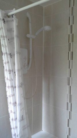 The shower above the bath at Brook Cottage self-catering cottage, Reynoldston, Gower