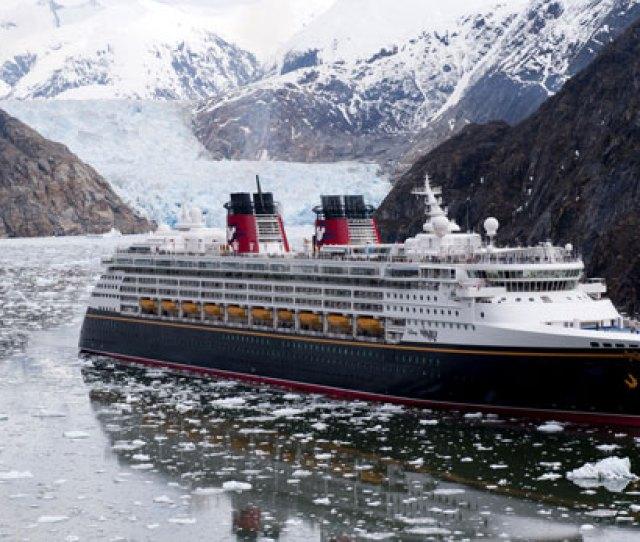 The Disney Wonder Cruise Ship Sails Past Glaciers At The Tracy Arm Fjord In Alaska