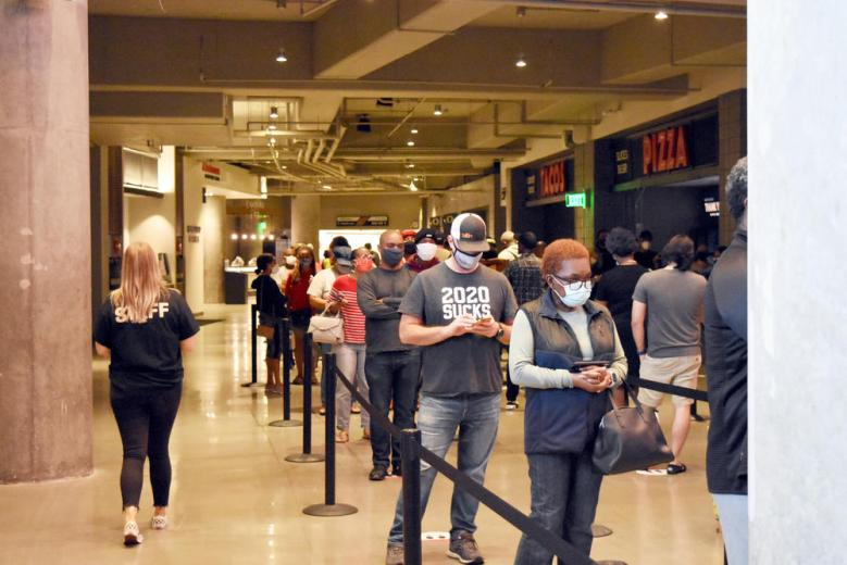 Hundreds of voters wait in line at State Farm Arena in Atlanta during the first day of in-person early voting Oct. 12, 2020.
