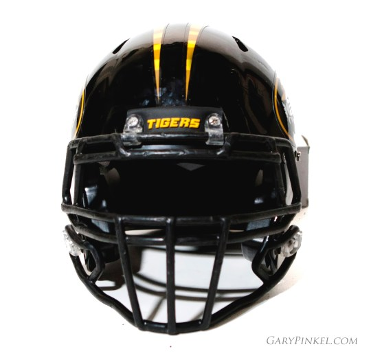 """The traditional Mizzou Tiger football helmet has a gold """"bumper"""" reading Tigers for a 3D look."""