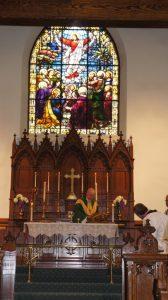 Grace Church Canton - Bishop Love Preparing Communion