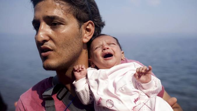 Dad and daughter. Refugee