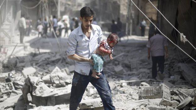 Dad carrying bloodied baby