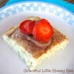 Strawberries on top of cinnamon pancake square.