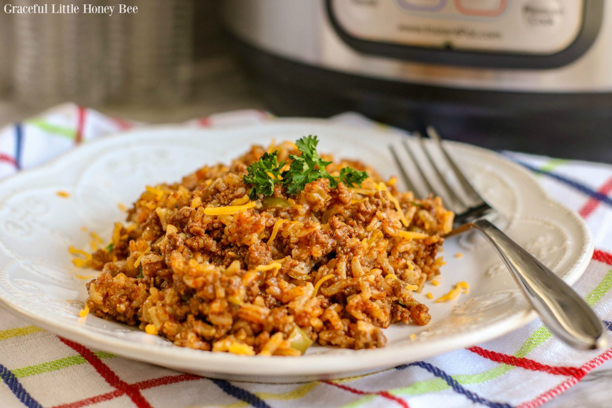 This recipe for Instant Pot Spanish Rice with Beef is full of savory flavor and makes a quick and easy weeknight dinner! Find the recipe on gracefullittlehoneybee.com #instantpot #pressurecooker #recipe #easyrecipes #dinner #beef #rice