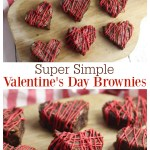 Heart shaped brownies on a wooden cutting board.
