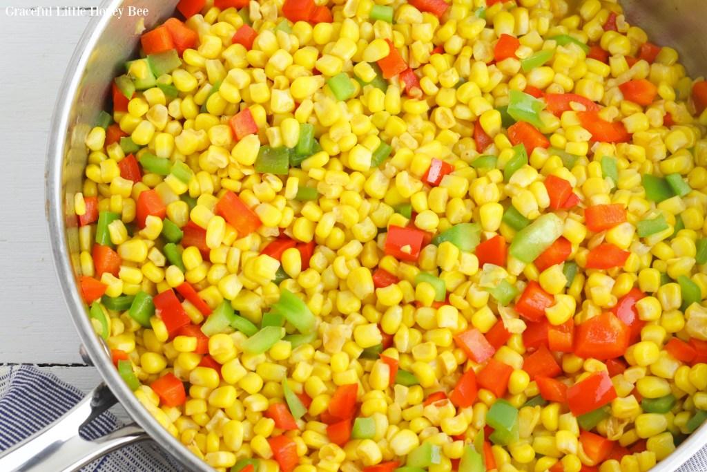 Fiesta corn in large round stainless steel skillet.