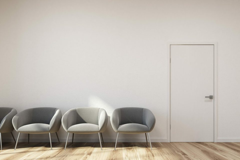 Modern,Waiting,Area,With,White,Walls,,A,Wooden,Floor,And