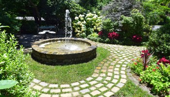 circular fountain and garden pathways at Mill Pond Garden in Lewes, Delaware