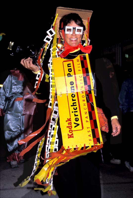 Martha Cooper dressed up as a 1950s roll of Verichrome Kodak Film for the Halloween Parade in NYC 1994.
